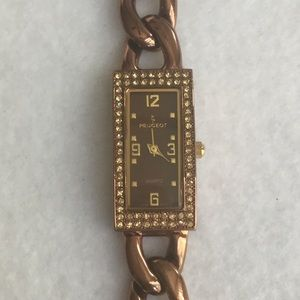 Bronze/copper Peugeot. Watch.  Needs battery
